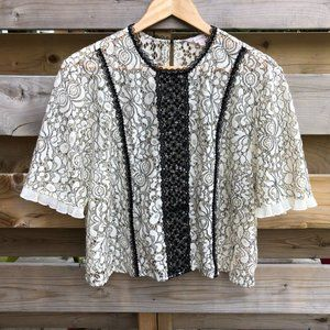 NANETTE LEPORE sheer lace with black trim blouse